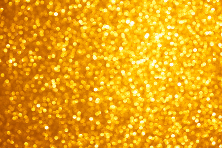 Golden lights bokeh background, abstract defocused glowing circles Stock Photo