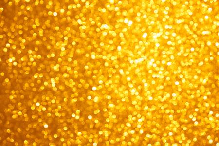 Golden lights bokeh background, abstract defocused glowing circles Standard-Bild