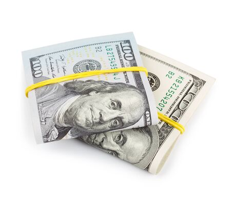 hoard: 100 Dollar bills folded and tied with rubber band isolated Stock Photo