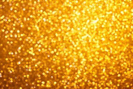 bokeh lights: Small warm bright golden lights bokeh background Stock Photo