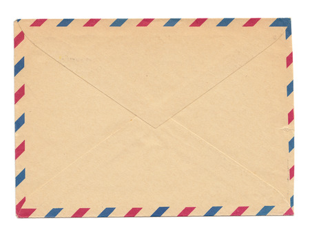 avion: Vintage envelope, blank, closed, old yellowed paper with par avion color marks Stock Photo