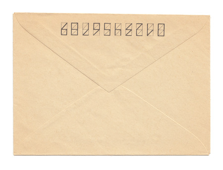yellowed: Yellowed paper vinatge envelope back side, closed, isolated on white