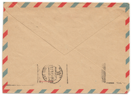 old envelope: Old paper envelope with meter stamp on rear side and one side cut off. Russian inscription: Manufactured