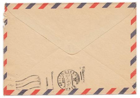 old envelope: Old worn paper envelope with meter stamp on rear side