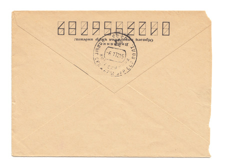 worn paper: Old worn envelope with USSR meter stamp, worn and yellowed paper, closed, isolated on white background. Russian inscription: Attention! Sample of filling zip-code Stock Photo