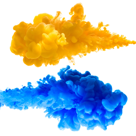 Orange and blue ink splashes in the water, isolated on white background Stock Photo