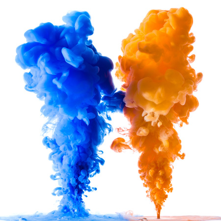 Orange and blue ink splashes in the water, isolated on white background Banque d'images