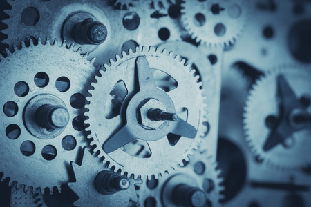 sprockets: Gears and cogs close-up, blue toned