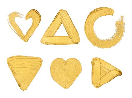 Goudverf stokes en vormen op een witte achtergrond Stockfoto