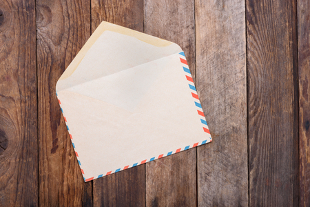 old envelope: Open vintage envelope on old wooden table Stock Photo