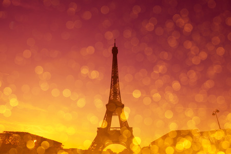 eifel: Eiffel Tower silhouette at evening sunset light in Paris France with shiny golden glitter double exposure effect Stock Photo