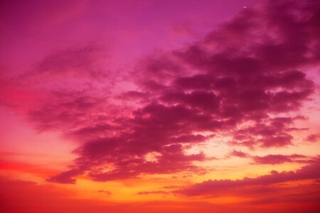 rainclouds: Colorful tropical sky with golden clouds at sunset time