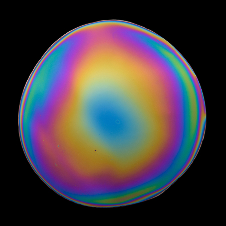 glitch: Multicolored iridescent film isolated on black background