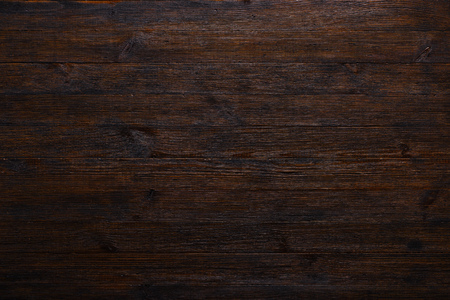 Dark wood table texture background top view