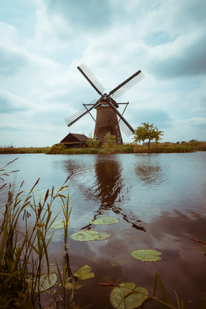 Traditional Dutch windmill retro color stylized
