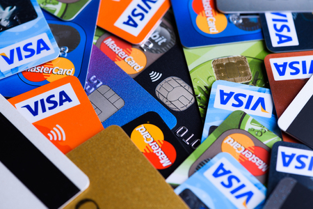 Krakow, Poland - June 16, 2017: Plastic bank payment cards, Visa and Mastercard, credit and debit. Editorial