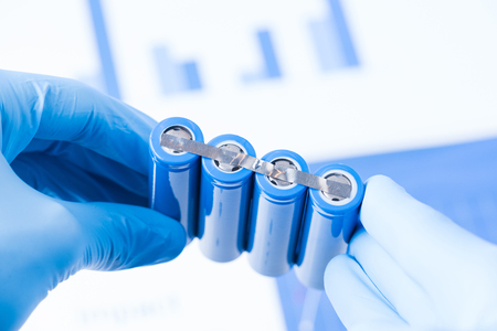 Scientist hold row of accumulators, research of new type of battery concept Stock Photo