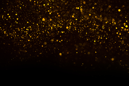 Unique abstract gold dust rain bokeh background Imagens