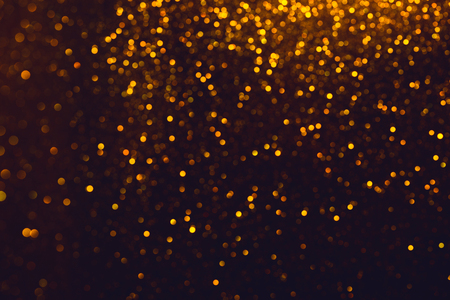 Shiny glitter bokeh. Glitter abstract background with golden lights and blank background.