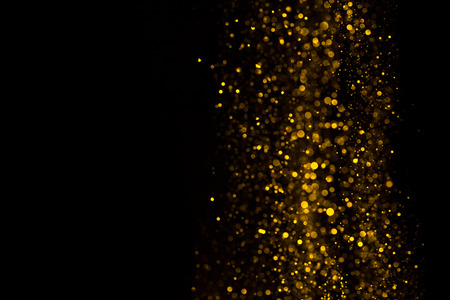 Falling glitter dust bright bokeh border on black background with copy space Stock Photo