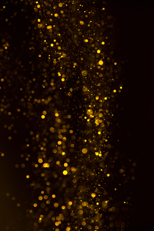Yellow glitter shiny abstract lights flow background