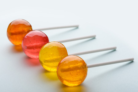 Lollipops assortment on pastel background Stock Photo