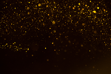 Glitter gold sparkling star dust falling shiny abstract bokeh background