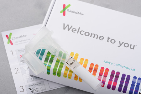 Kiev, Ukraine - 17 October 2018: 23andMe personal genetic test saliva collection kit, with tube, box and instructions. Illustrative editorial.