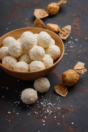 Homemade coconut candies on rustic table still life Stock Photo