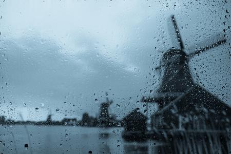 Dutch windmills at rainy weather