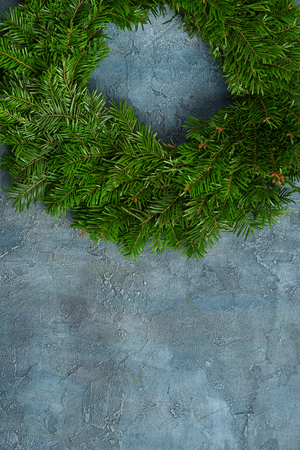 Natural fir christmas wreath fir tree xmas decoration on rustic background overhead view with copy space