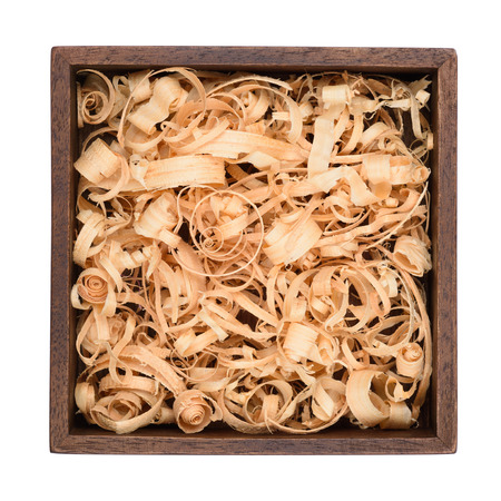Wooden box with wood shavings straw filling isolated on white. Top view.