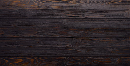 Dark wooden planks table background top view