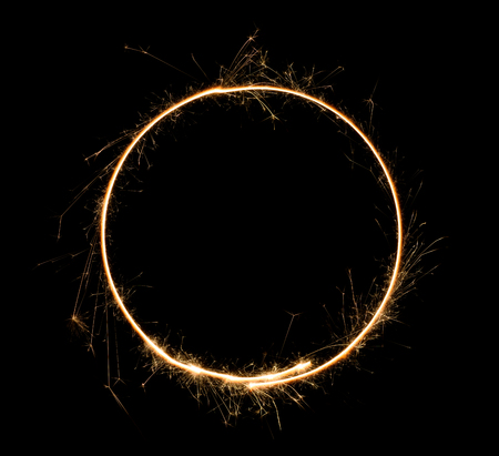 Sparkler circle. Burning bengal fire round letter o number zero. Isolated on black.