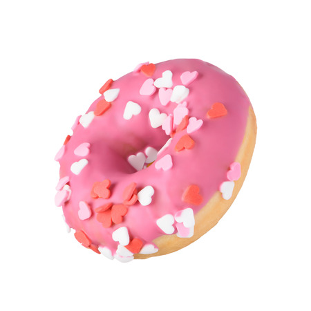 Pink donut with heart sprinkles decoration. Valentines day love sweet cute glazed dessert. Isolated donut flying tilted angle horizontally. Imagens