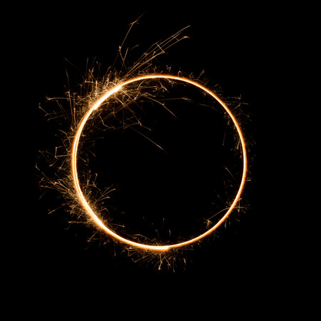 Sparkler circle shape. Burning bengal fire round letter o number zero, long exposure. Imagens