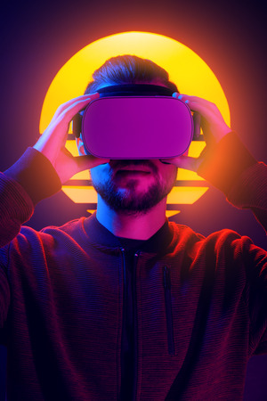 Man wearing virtual reality goggles wireless headset. VR videogame experience in 80s synthwave and retrowave futuristic aesthetics. Imagens