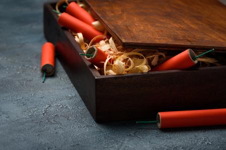Wooden box full of firecrackers Stock Photo