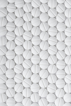 Drugs white tablets pattern abstract background, top view macro Stock Photo
