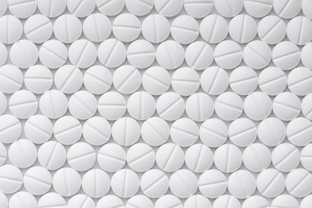Drugs tablets pattern top view macro Imagens