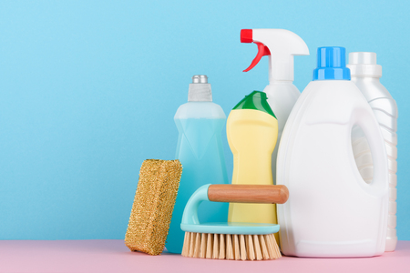 Cleaning service supplies on pastel background with copy-space. Stock Photo