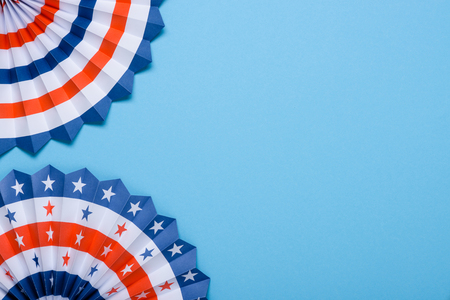 4th of July USA flag theme paper fans on blue background. Independence Day lanterns template. Stock Photo