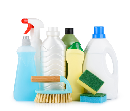 Cleaning liquids and tools set for different housework. Bathroom, kitchen, office house cleaning service equipment. Isolated on white background. Stock Photo