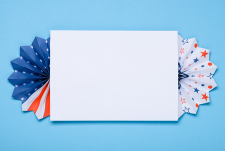 4th of July template. Paper fans stars USA Independence Day flag colors on blue background with copy-space.