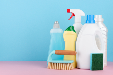 Cleaning liquids and tools set for different housework. Bathroom, kitchen, office house cleaning service equipment with copy space.