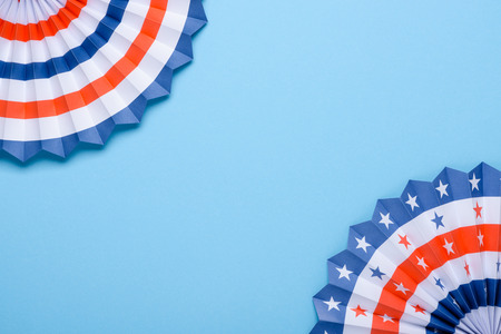 4th of July holiday banner design. USA theme paper fans on blue background flat lay. Independence Day lanterns template.