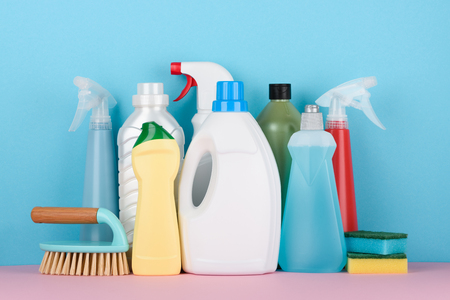 Cleaning supplies on pastel background