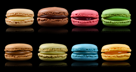 French macaron assortment isolated on black background. Macaroons cookies set. Stock Photo