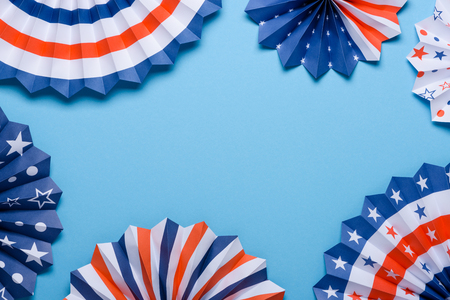 4th of July holiday banner design. USA theme paper fans on blue background. Independence Day lanterns template. Stock Photo
