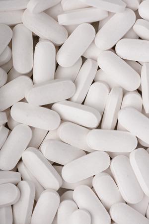 Pills tablets heap background top view